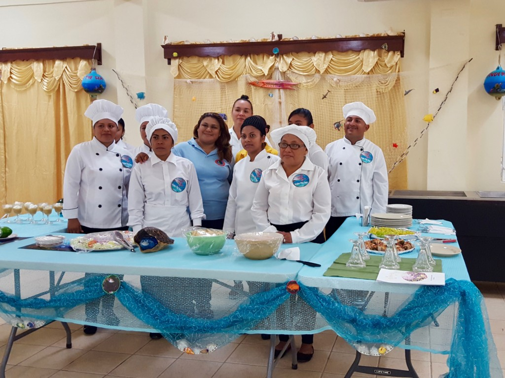 Food preparation trainees presenting their buffet style full meal course to MCCAP. Photo: Corozal ITVET